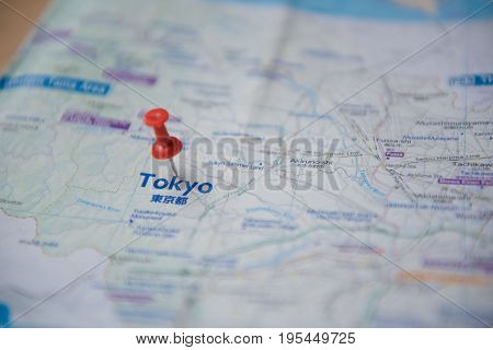 Tokyo map and push pin marking on a tourist .