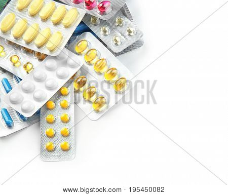 Health care concept. Blister packs with pills on light background