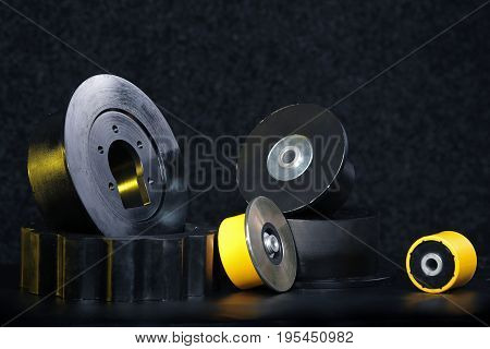 Group bearings and rollers for chassis harvester on a dark background