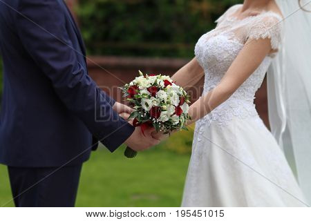 Bride and groom with bridal bouquet,  Romantic background