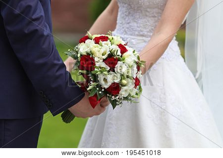 Bride and groom with bridal bouquet Close up