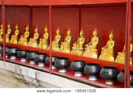 golden buddha statue in public temple at Thailand