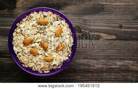 Oatmeal With Nuts Almonds . Oatmeal On A Wooden Table. Oatmeal Top View. Healthy Food .