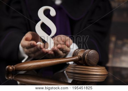 Striking mallet, Judgment concept, book background and Paragraph