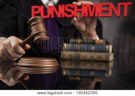 Judge, male judge in a courtroom striking the gavel