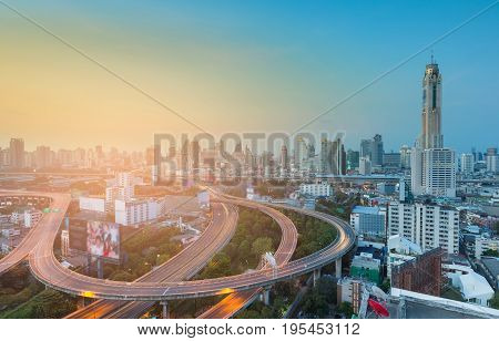 Bangkok city central business downtown background and overpass intersection with sunset tone cityscape background Thailand