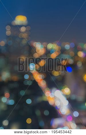 City blurred bokeh light with blue twilight sky abstract background