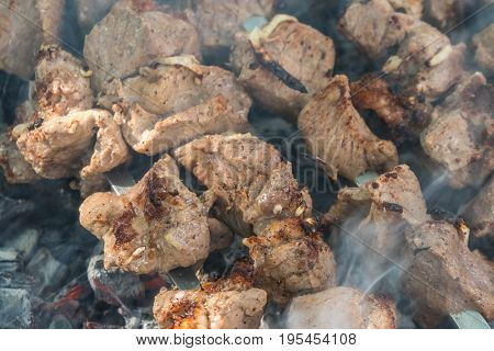 Georgian Mtsvadi (shashlik) Preparation. Smoking Shashlik On The Grill. Bbq On Stick