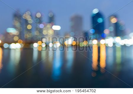 Blurred bokeh light offce building waterfront abstract background