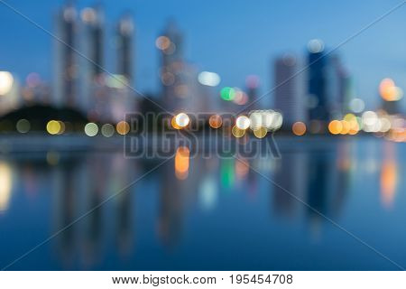 Night blurred bokeh light twilight sky offce building abstract background