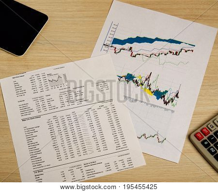 Showing business and financial report. stock charts .