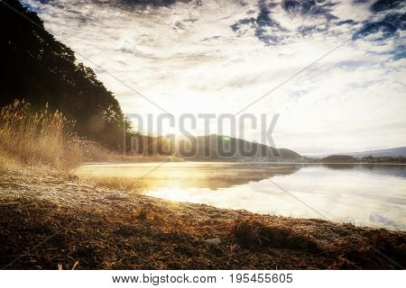 abstract morning fog on kawaguchiko lake and mount fuji with soft focus sun filter - can use to display or montage on product