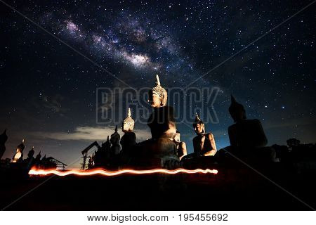 Background blur and sofe focus Milky Way and statues in the night sky dark vision blurred.In Thailand.