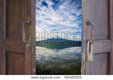 abstract old wood window open to see mount fuji lake view reflex on water - can use to display or montage on product