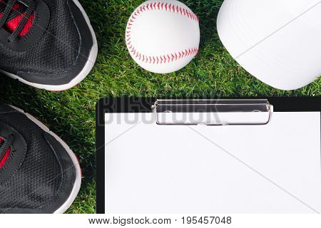 Concept on the grass of things for sports and a tablet for recording the result