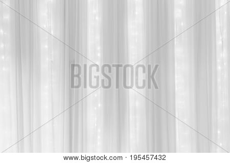 white pleat fabric background with rope light
