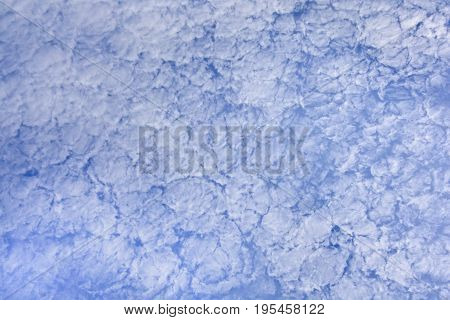 Background of high icy clouds against the blue sky. High clouds on a clear summer day.