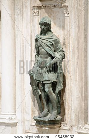 Statue of Mars the Roman God of War sculpted by the Renaissance artist Antonio Rizzo and displayed on an exterior wall of the Doge's Palace Venice.