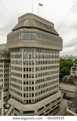 Headquarters of the Ministry of Justice for the UK Government in Westminster London. The Ministry is responsible for the Courts and Prisons of England and Wales. Elevated view on a cloudy Summer day.