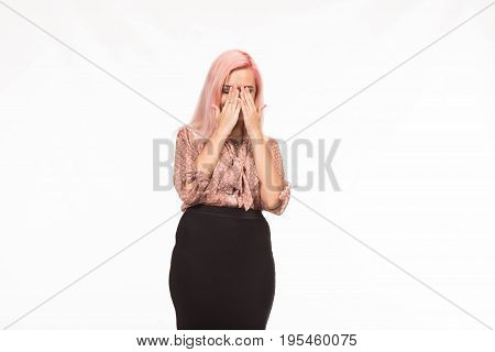 Young jocular woman portrait of a confident businesswoman showing presentation, pointing placard background. Ideal for banners, registration forms, presentation, landings, presenting concept.