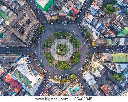 Road roundabout with car lots in the city in Thailand.Sixth Street intersection is beautiful.cityscape.Light evening.Aerial view.