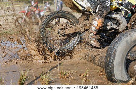 Two stroke engine Enduro bike in muddy track .