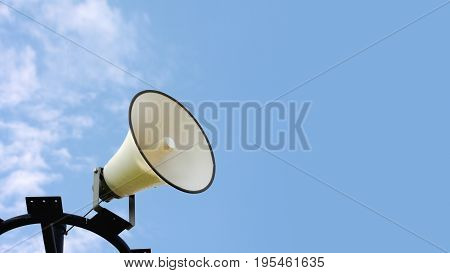 loudspeakers in park with blue sky background