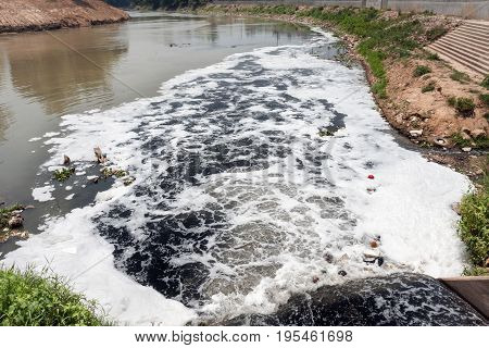 Water pollution in river because industrial not treat sewage before drain .