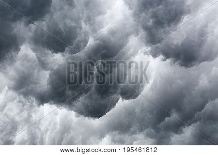 Background of storm clouds on the sky .