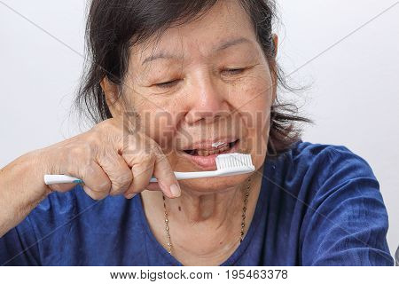 Asian elderly woman with a toothbrush. Dental health