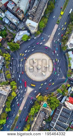 Aerial view Road roundabout Expressway with car lots in the city in Thailand. Street large beautiful downtown cityscape Top view.