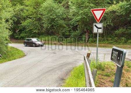 Rural crossroads in the Czech Republic. Traffic sign takes priority