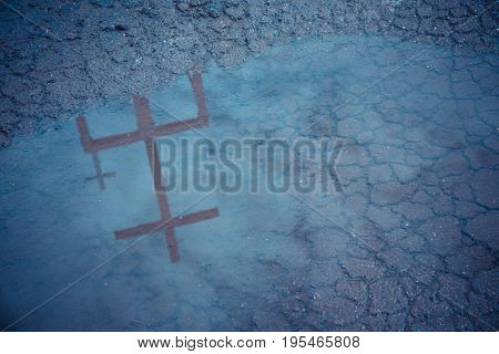 Christ Cross Shadow Reflected In Water .
