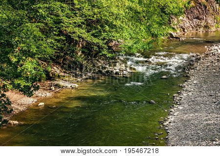 River With Rocky Shore. View From Above