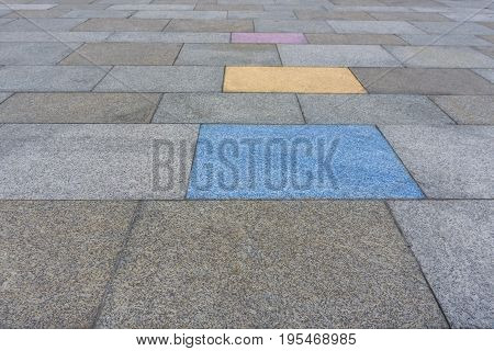 Close-up of Painted Stones. View on colored Stones of a Walkway. Pedestrian Walkway
