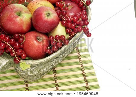Currants and apples in a vase. Red Currants
