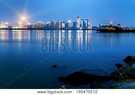 Riverside cityscape sky and city skyline Nanchang China.