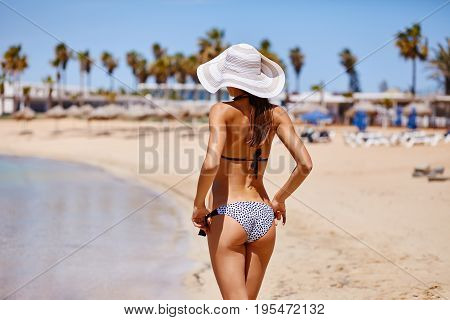 Sexy Back Of A Elegant Tanned Woman Relaxing In Bikini On Sea Background. Sexy Buttocks. Ayia Napa,