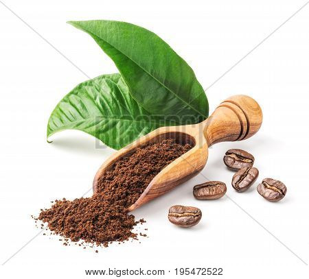 Ground coffee and green leaves isolated on white background