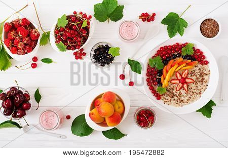 Tasty And Healthy Oatmeal Porridge With Berry, Flax Seeds And Smoothies. Healthy Breakfast. Fitness
