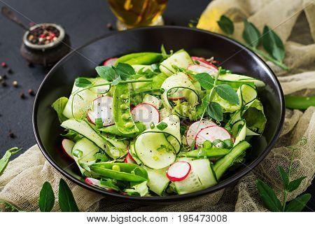 Fresh Salad Of Cucumbers, Radishes, Green Peas And Herbs
