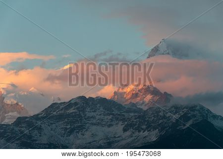 sunlight in the evening is lighting the snow mountain feeling warmth and beautiful for background