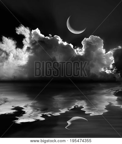 Moonlit fluffy clouds and crescent moon reflection in black and white