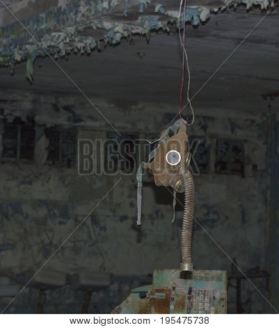 Gas Mask hanging in Abandoned Room in Ghost Town of Pripyat within Chernobyl Exclusion Zone