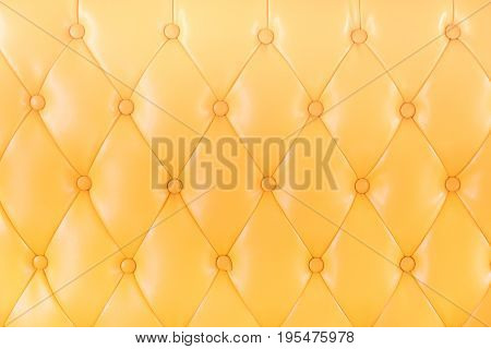 Yellow sofa in the living room abstract background copy space.