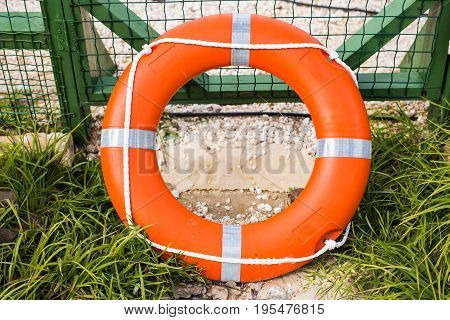 Marine lifebuoy on fence, safe for swim