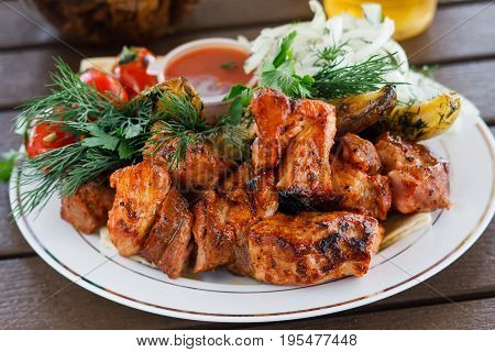 Close-up view of ready to eat beef shashlik. Russian traditional food. Served in cafe