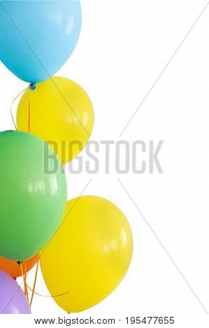 holiday, decorations for birthday, joy concept - brightly colored inflated balloons on ribbons, five colors, blue, yellow, green, orange, violet, copy space, vetical, isolated on white background.