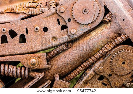 Gear Wheels And Sprockets Closeup. Rusty Parts Of Old Machines.