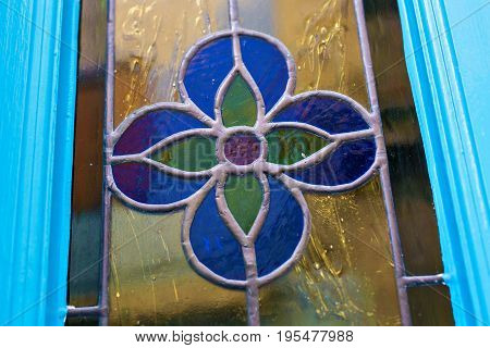 Details of the stained-glass window of blue flower